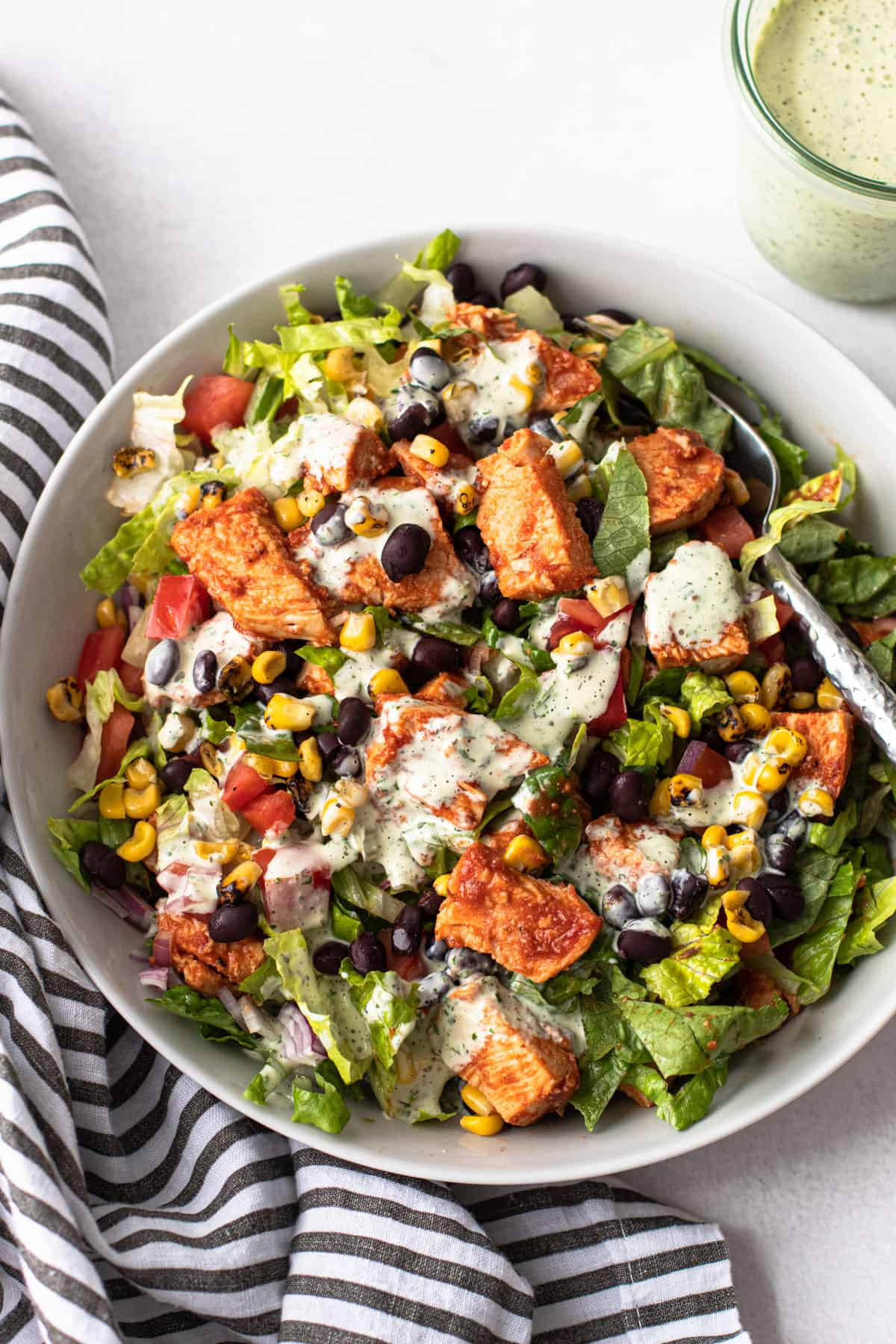 BBQ Chicken Salad in a bowl with cilantro ranch dressing.