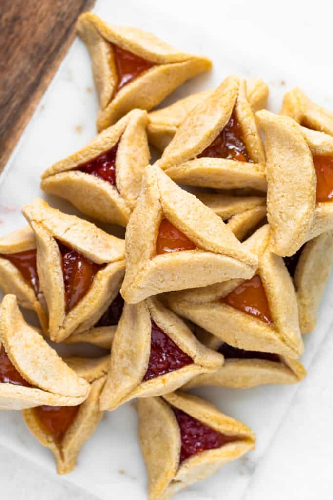 Paleo hamantaschen with apricot and raspberry jam.