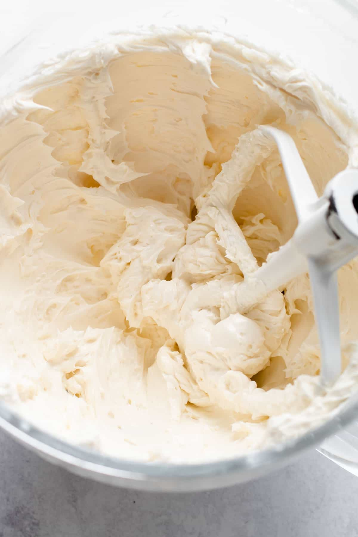 Whipped buttercream in a mixing bowl.