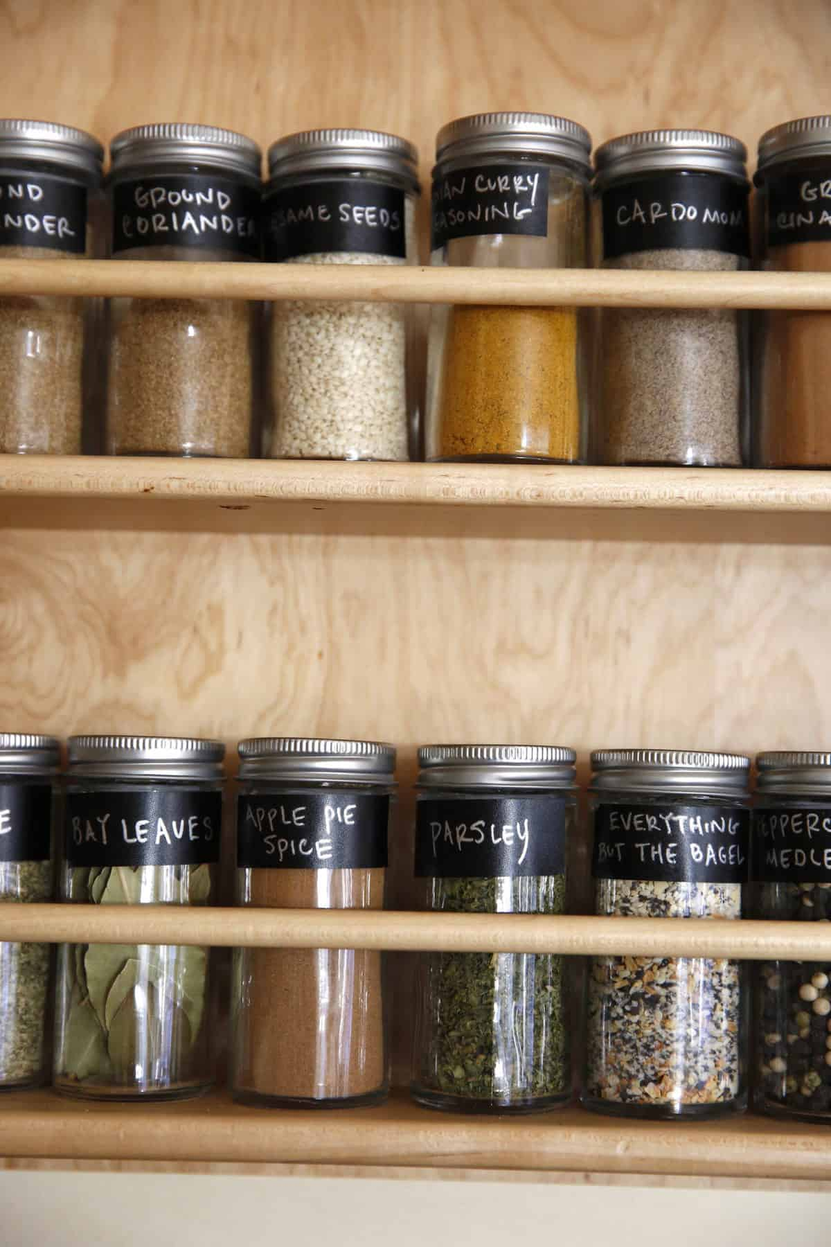 Storing spices in jars with labels.