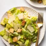 Caesar salad on a plate.