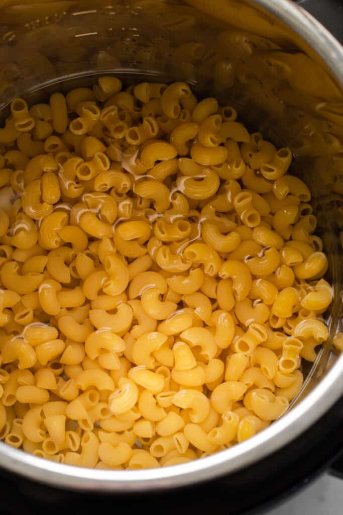 Uncooked elbow pasta in the instant pot.