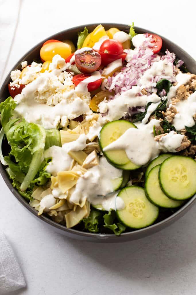 A mediterranean chopped turkey salad with creamy dressing.