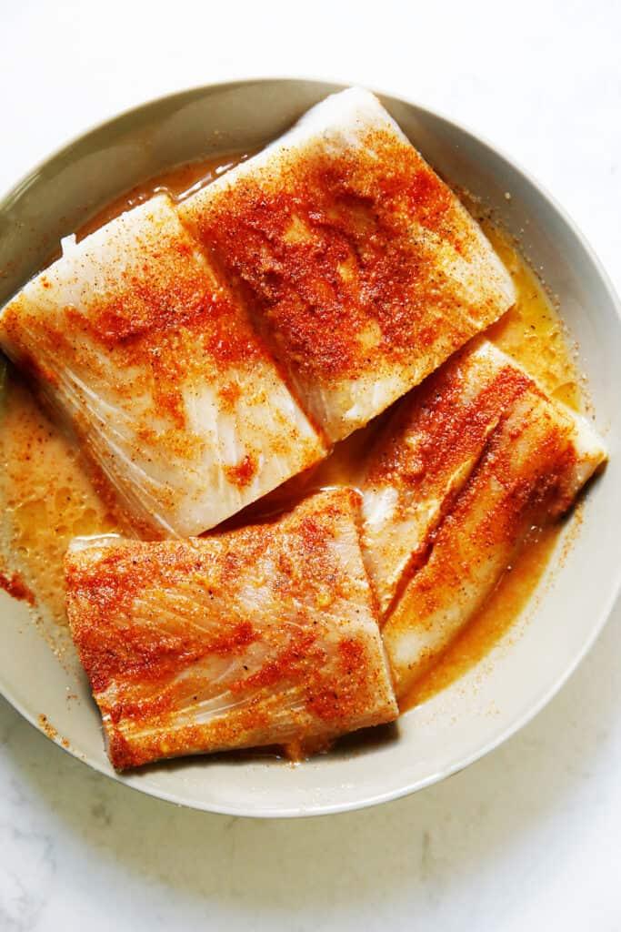 Mahi mahi marinade in a dish.