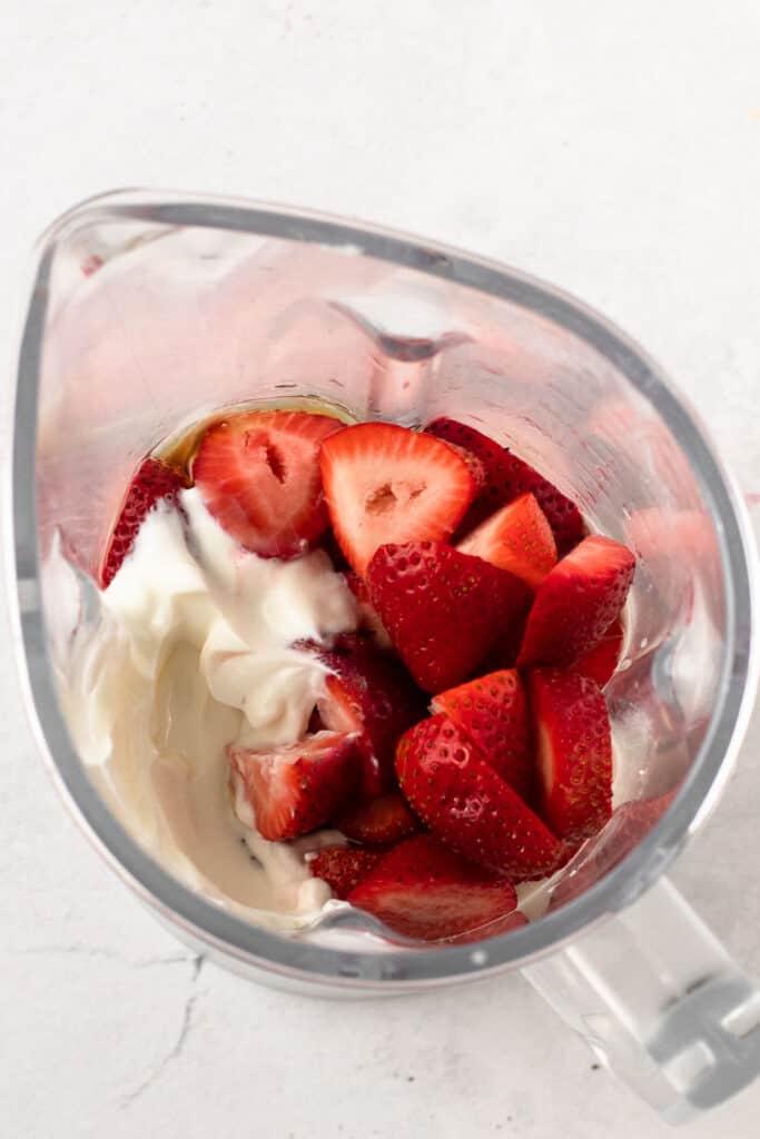 Greek yogurt popsicle ingredients in a blender.