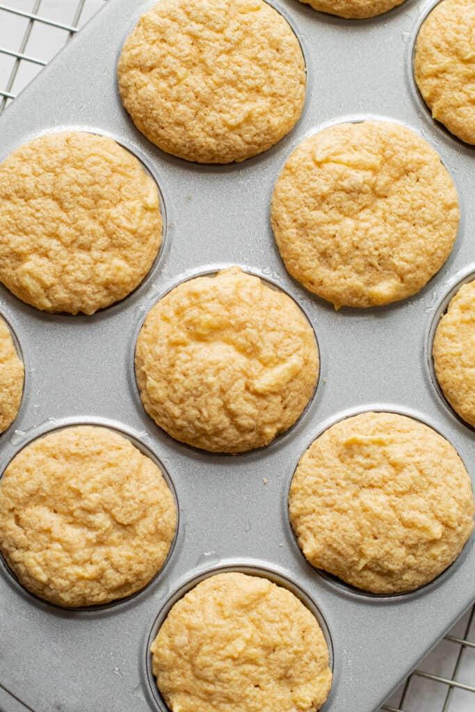 Mini oat muffins in a muffin tin.