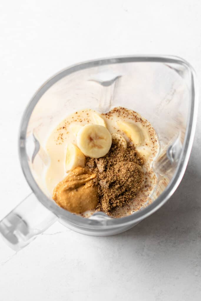 Peanut Butter and banana smoothie ingredients in a blender.