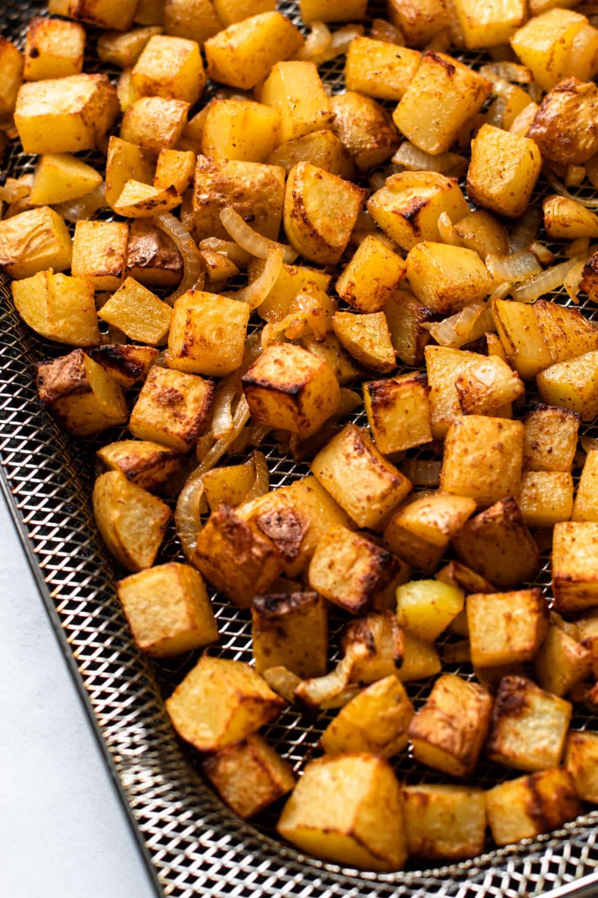 Crispy air fried potatoes still in the basket.
