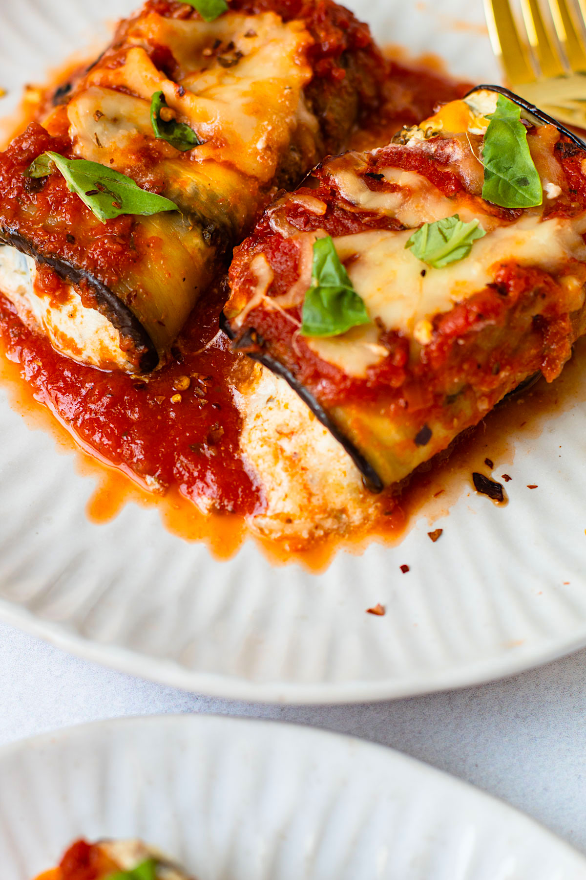 Eggplant rollatini on a plate.