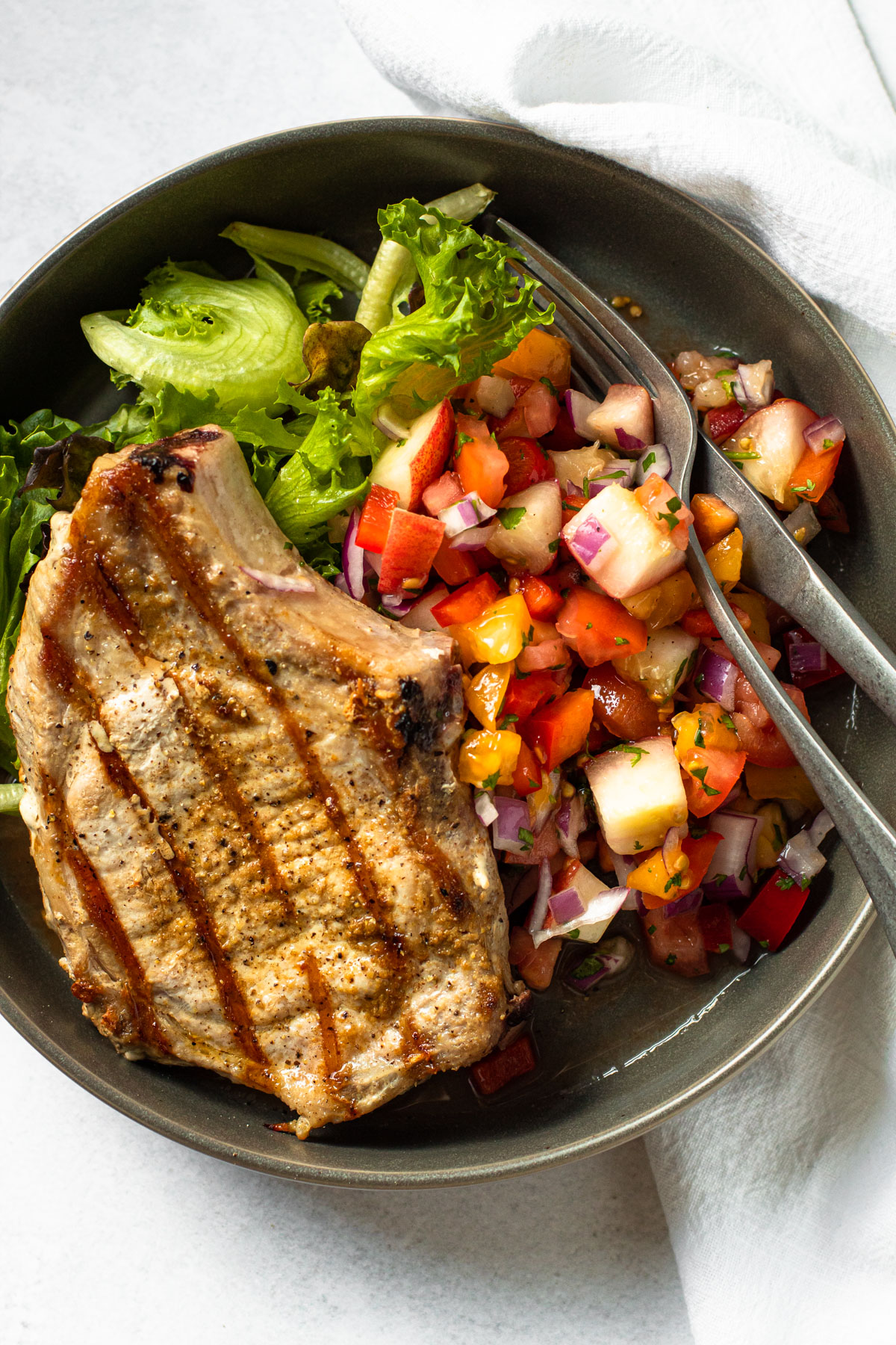 Grilled pork chops with peach salsa.