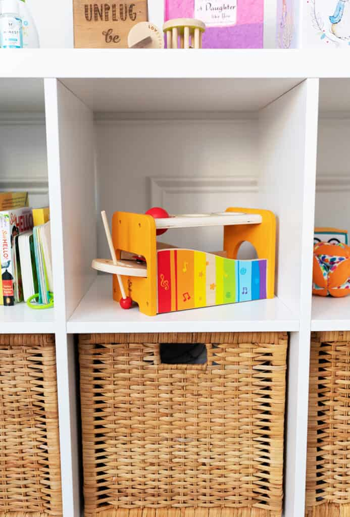 A shelf with non toxic baby toys.