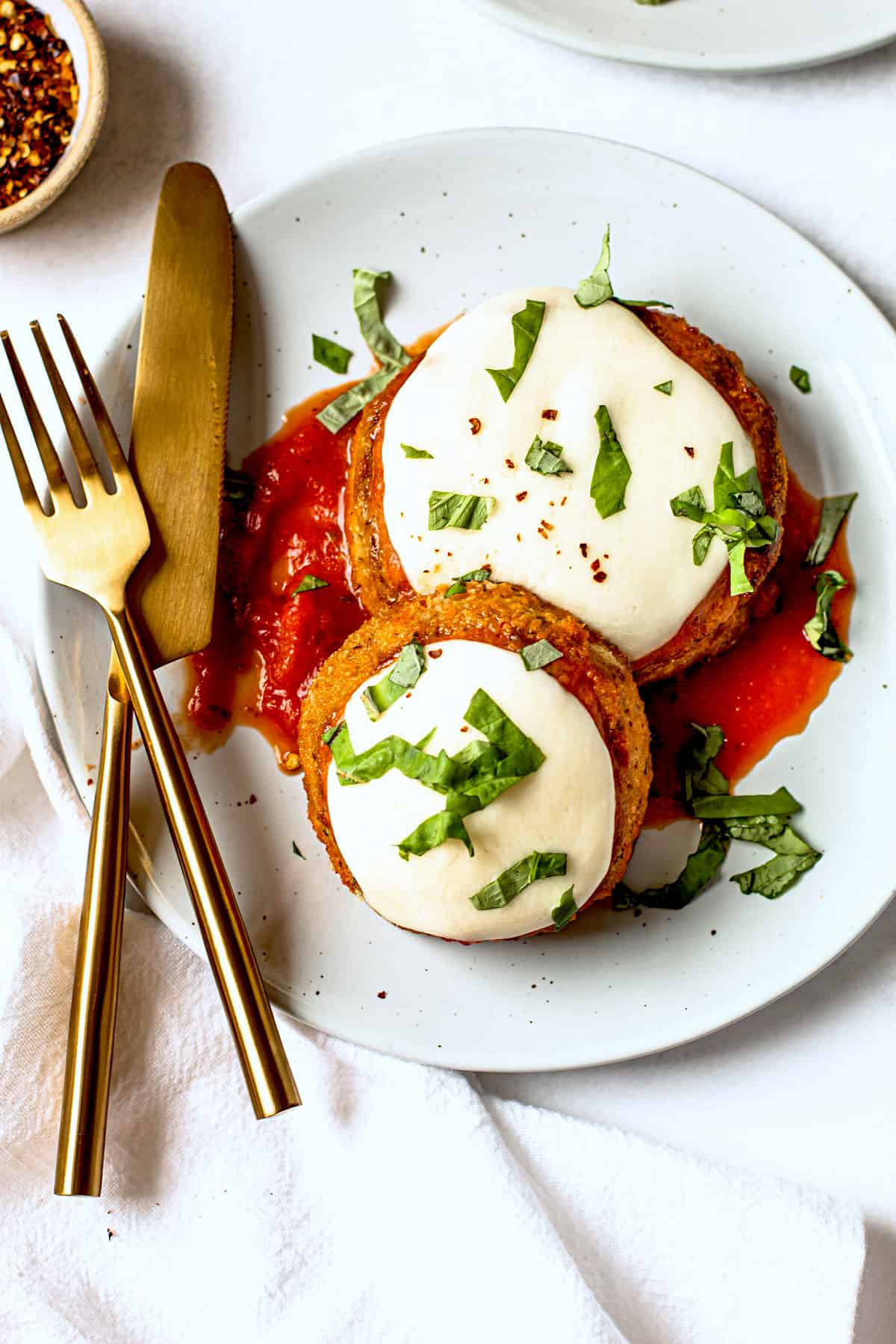 Air fryer eggplant parm on a plate.