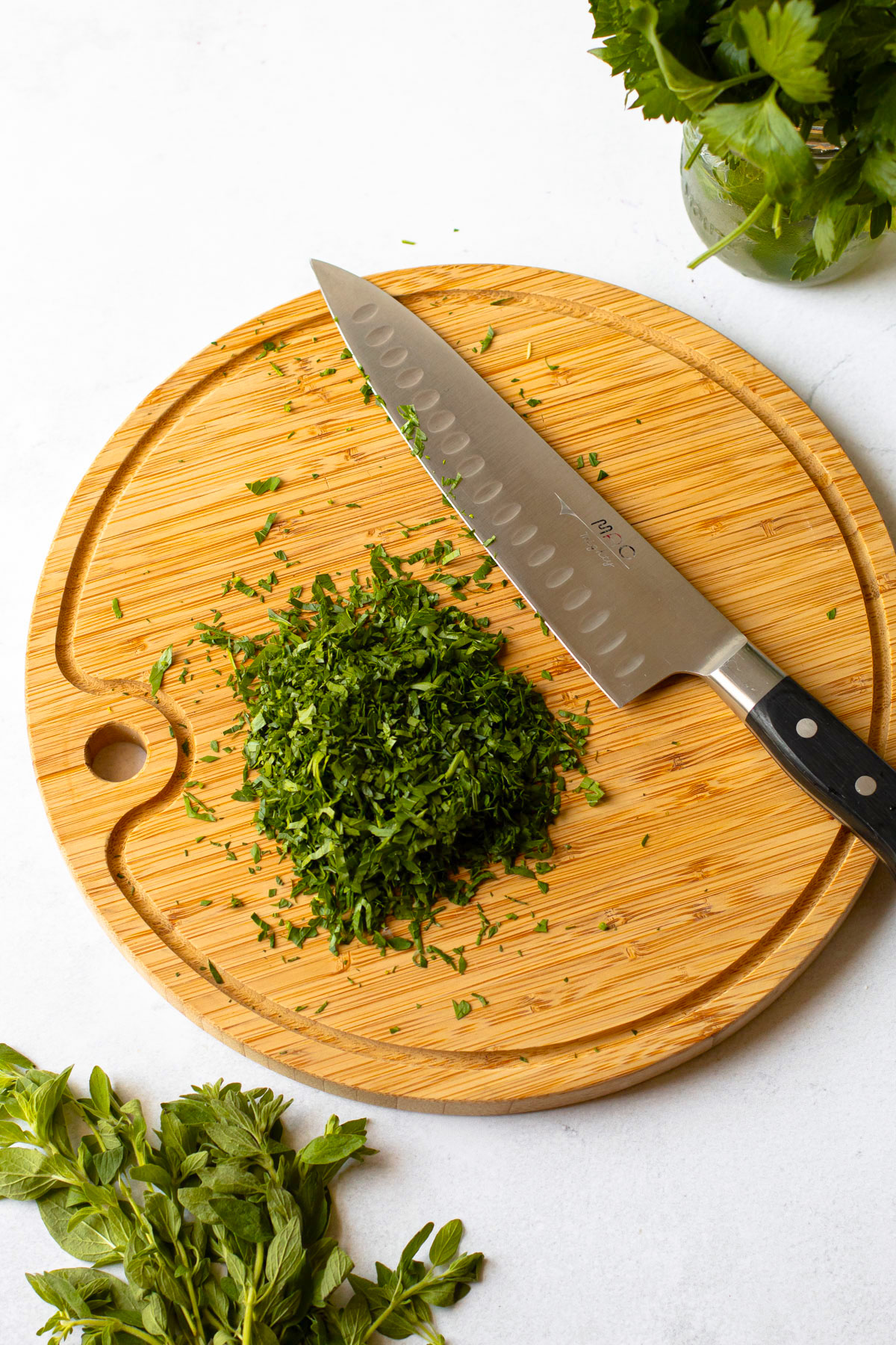 Chopping up herbs for chimichurri.