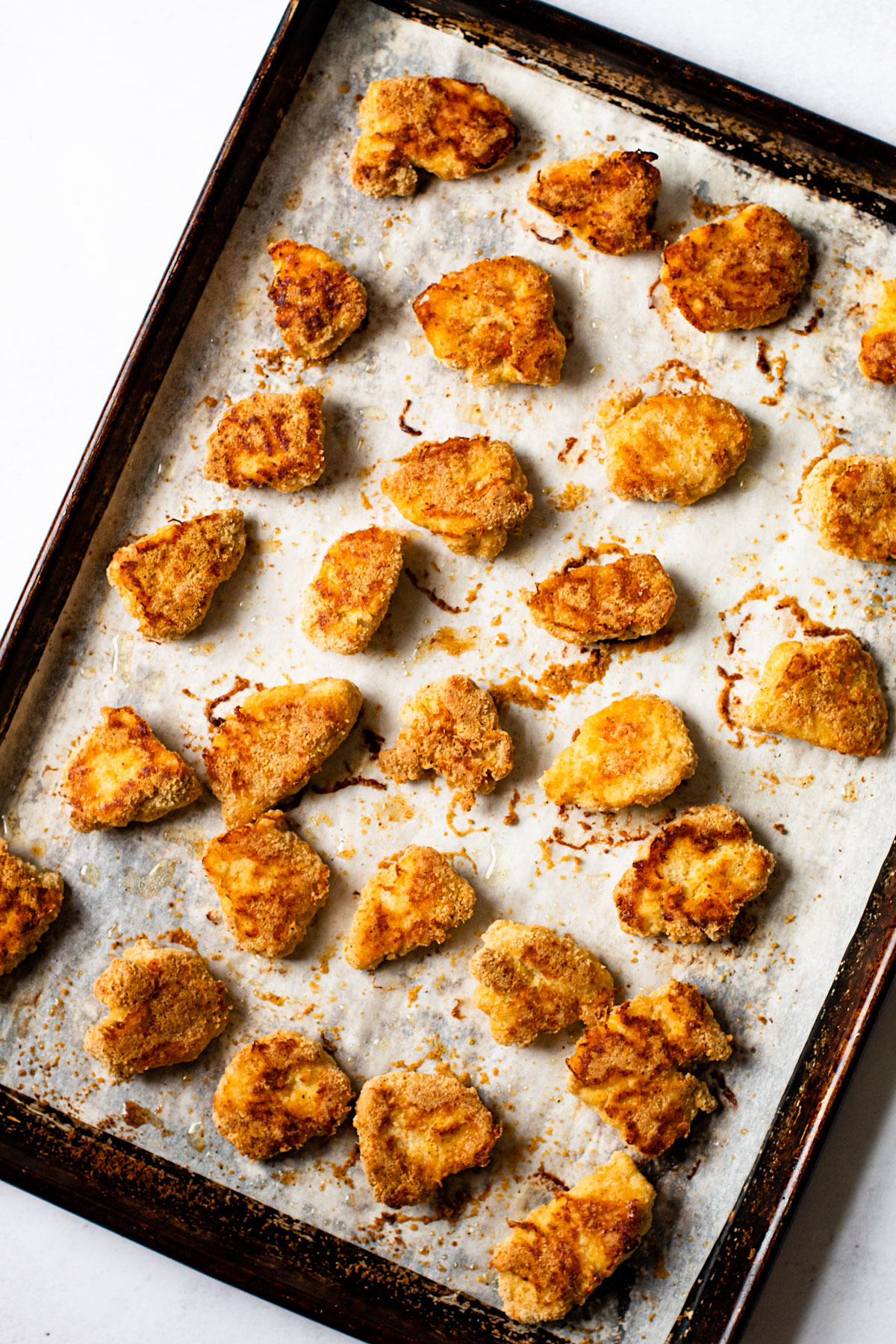 Gluten-free chicken nuggets that are baked.