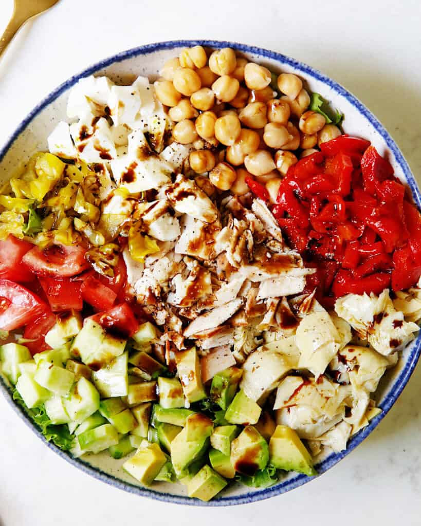 chopped salad recipe with dressing on it